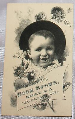 Antique Victorian Trade Card Advertising A book store Leavenworth KS Baby in Hat