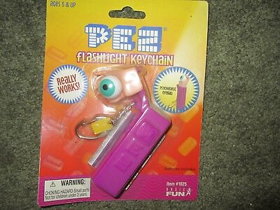 Pez candy dispenser, never used - in package, Flashlight Keychain, giant eyeball