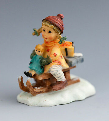 Lovely M J  Hummel miniature figurine - girl on sled