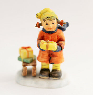 Lovely M J  Hummel miniature figurine - girl with sled