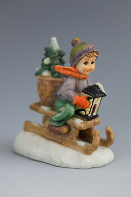 Lovely M J  Hummel miniature figurine - boy on sled