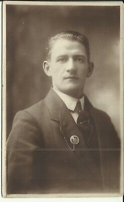 1 x WW1 era postcard, ex - soldier wearing  a Silver War Badge