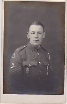 WW1 RPPC - Royal Field Artillery Staff Sergeant, 1st Division Insignia & whistle
