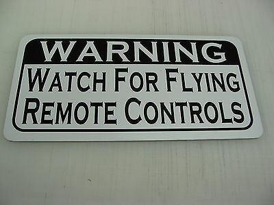 WATCH FOR FLYING REMOTE CONTROLS Metal Sign 4 Man Cave Football Baseball Hockey