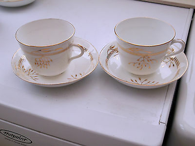 Two White China Cups And Saucers With A Gold Coloured Leaf Pattern  No Maker