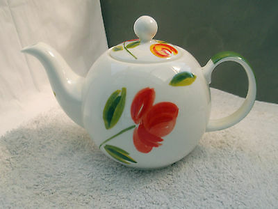 One Pint Royal Crown Teapot With A Floral Pattern