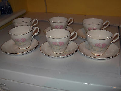 Six Argyle Cups And Saucers Lemon And Pink Floral Pattern Edged In White