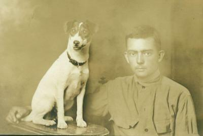 ca. 1918 WWI ERA SOLDIER w DOG on TABLE, MILITARY PET JACK RUSSELL ? WORKING DOG