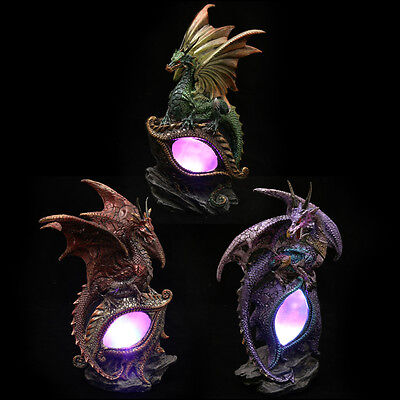 Fantasy dragon eye figurine light up led dragons red purple or green 20 cm high