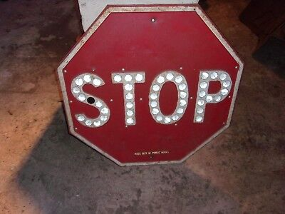 big painted red over yellow porcelain cats eye stop sign