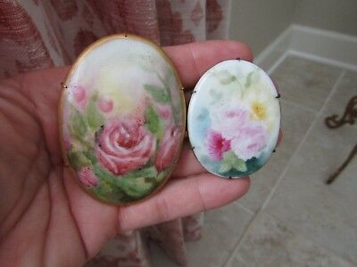 Pair of Antique hand painted floral porcelain   pins, large with gold rim