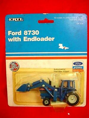 FORD 8730 TRACTOR  with END LOADER - 1990 - ERTL - 1/64TH - ORIG PKG.