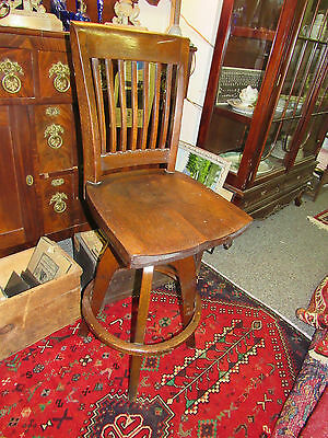 Antique oak industrial drafting table swival chair , bar height chair