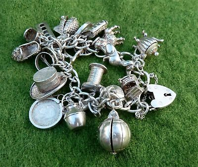 VINTAGE 1970s SILVER CHARM BRACELET WITH 18 CHARMS ATTACHED - OVER 2.5oz
