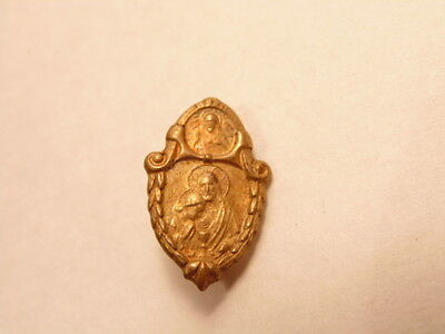 Vintage small brass colored 1st Communion pin showing Christ's Sacred Heart