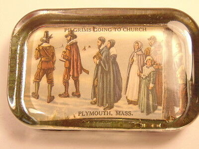 Older glass paperweight showing the Pilgrims going to Church,  Plymouth, Mass.