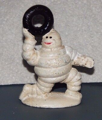 MICHELIN TIRE MAN  FIGURINE Kneeling Holding Tire Up CAST IRON Advertising Promo
