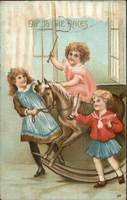 Christmas??? Kids on Toy Rocking Horse OFF TO THE RACES c1910 Postcard