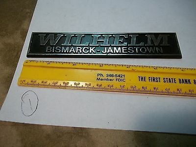 Old Plastic Car Dealer Emblem WILHELM Bismark Jamestown