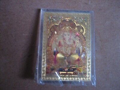 Gold Coloured Picture Of Hindu God Ganesh