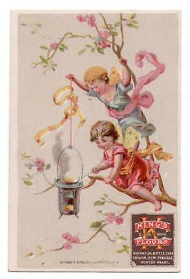 Advertising trade card   King's Flour  Winged cherubs cook in tree