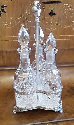 Vintage 3 Bottle Crystal Cruets In Silver Plated Reprousse Stand By Apollo
