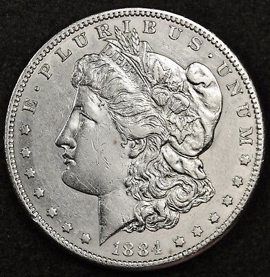 1884-s Morgan Silver Dollar.  Chest Feather's.  A.U.  118579