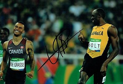 Usain BOLT Rio 2016 Olympic Athlete SIGNED 12x8 Photo AFTAL Autograph COA