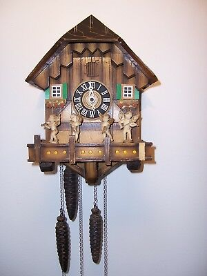 vintage CUCKOO CLOCK MFG. CO.  GERMAN ANIMATED MUSICAL CLOCK old movement wood