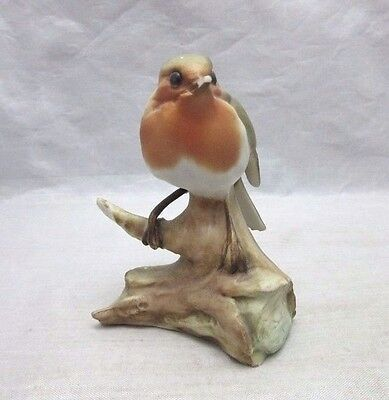 Porcelain robin bird on a branch figurine