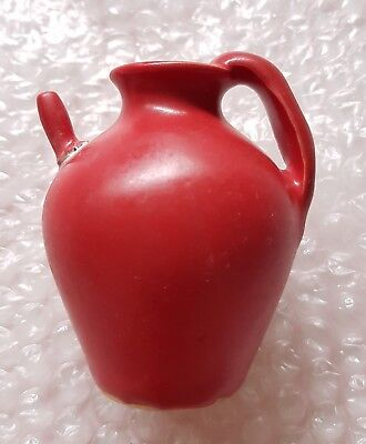 China, Tang Dynasty, a red glazed porcelain water dropper from Ding kiln