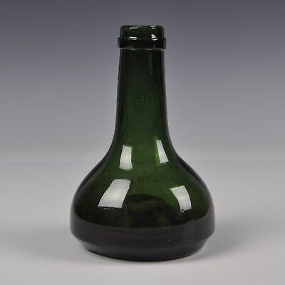 A Small Antique Dutch Green Glass Wine Bottle From The 18th Century
