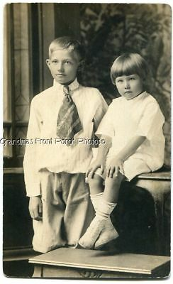 EARLY 1900s RPPC CUTE BOYS w PLAID TIE & KNICKERS ANTIQUE REAL PHOTO POSTCARD