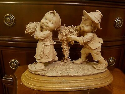 Capodimonte  G. Armani  Boy and Girl carrying Grapes  Figurine Gullivers World