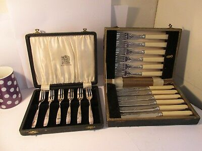 2 boxed sets of cutlery.    18 items
