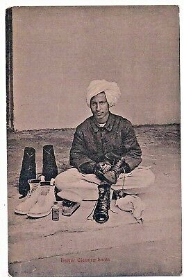 INDIA -  SOCIAL HISTORY - A BEARER CLEANING BOOTS, 1910s