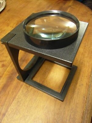 Pocket sized magnifying lens on stand