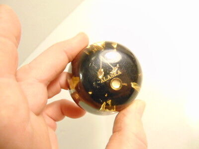 small cast resin or lucite Alaska souvenir paperweight with gold flakes or leaf