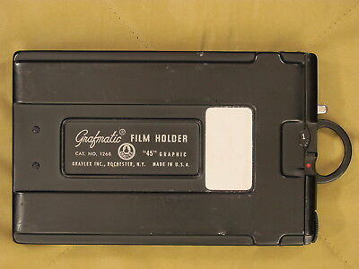 Grafmatic 4 by 5 sheet film holder by graflex graphic holds 6 sheets of film