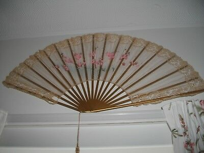 A large antique painted silk fan with gilt wooden sticks & boards