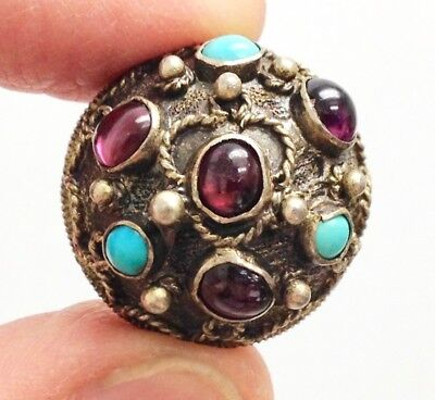 Peasant button encrusted with turquoise and rubies. Folk silver with domed top.