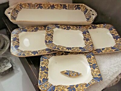 Woods Ivory Ware Decorative Sandwich Tray And Four Square Plates   A / F