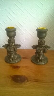 Pair Of Wooden Candlesticks With Cherubs. Charity Sale