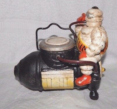 MICHELIN TIREMAN SITTING ON AIR COMPRESSOR GETTING INFLATED Cast Iron Bank PROMO