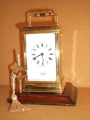 Vintage brass carriage clock with five bevelled glasses and KEY. Perfect cond'n.