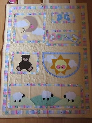 Wall hanging with pockets for a nursery