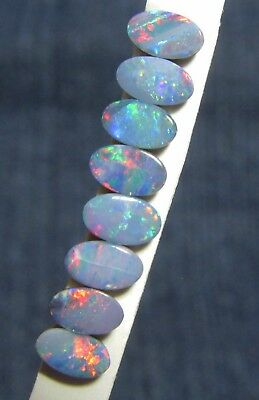Set of 8 very bright 5 mm x 3 mm opal doublets, bright red & green flashes