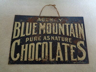 1920's Vintage Original Blue Mountain Chocolates Candy Embossed Tin Sign
