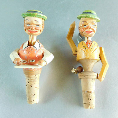 2 Vintage ANRI Wood Carved Bottle Stoppers Mechanical Carving Reading Waving