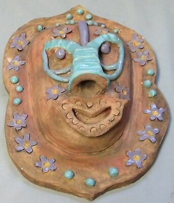 Tribal Ceramic Mask Wall Hanging turquoise, Yellow, and Purple glazes + flowers